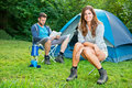 Couple on camping a young relaxing in front of a tent Royalty Free Stock Photography