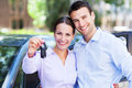 Couple with car keys young to new Stock Photo