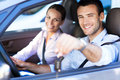 Couple in car young with keys to new Royalty Free Stock Image