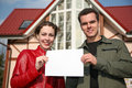 Couple with card and house Royalty Free Stock Photo