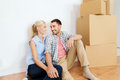 Couple with cardboard boxes moving to new home Royalty Free Stock Photo