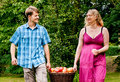 Couple carrying basket with apples Royalty Free Stock Image