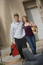 Couple Carrying Luggage Royalty Free Stock Photos