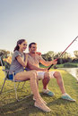 Couple catching fish Royalty Free Stock Photo