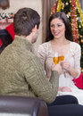 Couple celebrate christmas night holding glasses with champagne and Royalty Free Stock Photos