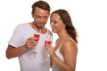 Couple celebrating with champagne attractive romantic young elegant flutes of pink smiling happily as they stand arm in arm Stock Photos
