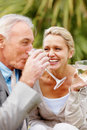 Couple celebrating with drinks for some occasion Royalty Free Stock Photography