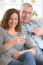 Couple celebrating in home happy with wine hands Royalty Free Stock Images