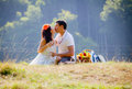 Couple celebrating together at picnic Stock Photo
