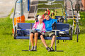 Couple chair lift enjoying landscape Royalty Free Stock Image