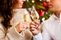 Couple with champagne on Christmas Eve Royalty Free Stock Photo