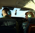 A Couple Chat as They Pilot a Small Plane Royalty Free Stock Image