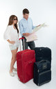 Couple checking destination map young surrounded by baggage a Stock Photos