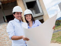 Couple checking their house project Stock Image