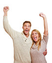 Couple cheering with clenched fists Royalty Free Stock Photography