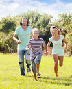 Couple with child playing running in summer middle aged Royalty Free Stock Photo