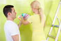Couple choosing paint for painting men making face he not like the chosen color Royalty Free Stock Photography