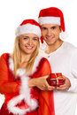 Couple at Christmas with Santa Claus hats Stock Images