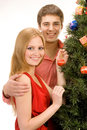 Couple by the christmas tree Royalty Free Stock Photography
