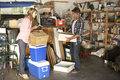 Couple Clearing Garage For Yard Sale Royalty Free Stock Photo