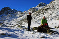 Couple of climbers having a brake in retezat mountains romania this image presents at the bottom peak Stock Image