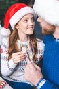 Couple clinking champagne glasses on christmas Royalty Free Stock Photo
