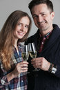 Couple clinking champagne Royalty Free Stock Photo