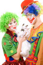 Couple of clowns with a white rabbit Stock Photos