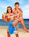 Couple with cocktail at Hawaii wreath beach