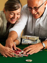 Couple collecting gambling chips at casino Royalty Free Stock Photo