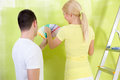 Couple with color samples to paint their new apartment Royalty Free Stock Photo