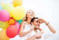 Couple with colorful balloons at seaside summer holidays celebration and dating concept Royalty Free Stock Photography