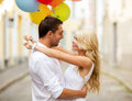 Couple with colorful balloons summer holidays celebration and dating concept in the city Royalty Free Stock Image