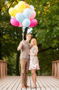 Couple with colorful balloons summer holidays celebration and dating concept in the park Royalty Free Stock Photography