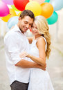 Couple with colorful balloons summer holidays celebration and wedding concept and engagement ring Stock Photography