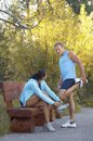 Couple Conversing As They Prepare Themselves For A Jog Stock Images