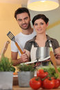 Couple with a cookbook Stock Photography