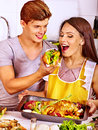Couple cooking chicken at kitchen happy Stock Image