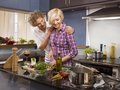 A couple cooking in the kitchen Royalty Free Stock Image
