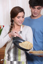 Couple cooking pancakes morning Stock Photo