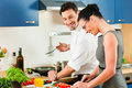 Couple cooking together in kitchen Royalty Free Stock Photo