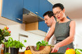 Couple cooking together in kitchen Royalty Free Stock Image