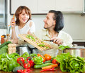 Couple cooking veggy lunch loving happy Stock Photography