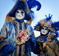 Couple in costumes on Venetian carnival Royalty Free Stock Photo
