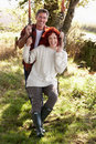 Couple with country garden swing Stock Photo