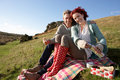 Couple on country picnic Royalty Free Stock Photo