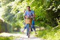Couple on cycle ride in countryside having fun Royalty Free Stock Photo