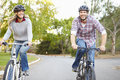 Couple on cycle ride in countryside smiling Royalty Free Stock Photography