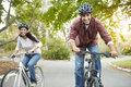 Couple on cycle ride in countryside smiling Stock Photography