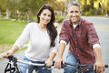 Couple on cycle ride in countryside smiling to camera Stock Photos